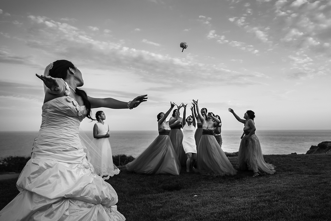 A bride throws her bouquet